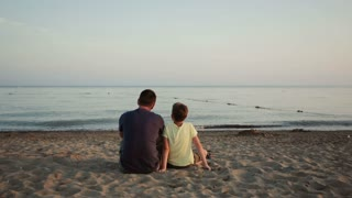 Young father and son on the beach