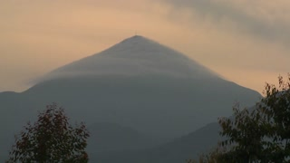 A beautiful time lapse of clouds blowing over the top of a Virunga volcano on the Rwanda Congo border.