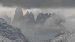 A beautiful time lapse shot of clouds moving over the mountains in Torres Del Paine, Patagonia, Argentina.