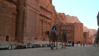 A camel passes the ruins of Petra, Jordan.