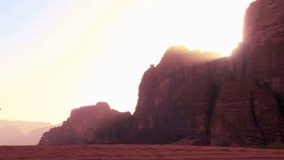 A camel train crosses the Saudi desert in Wadi Rum, Jordan.