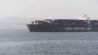 A Chinese cargo ship leaves China loaded with containers.