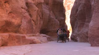 A horsecart passes through the narrow canyons leading up to Petra, Jordan.