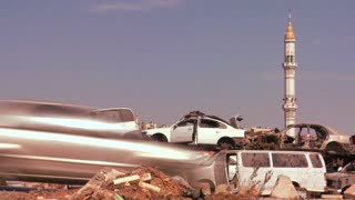 A junkyard stands in front of mosque in the Palestinian Territories and Judean Hills of Israel.