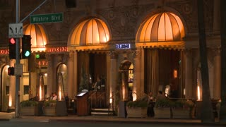 A luxurious restaurant at night along Wilshire Blvd in Los Angeles at night.