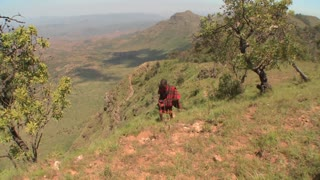 A Masai warrior walks along the edge of the world in Northern Kenya.