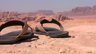 A pair of well worn sandals sits in the Saudi desert of Wadi Rum, Jordan.