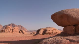 A rock shaped like a mushroom stands in the Saudi desert near Wadi Rum, Jordan.