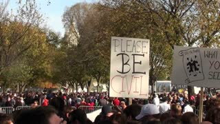 A sign at a political rally implores people to please be civil.