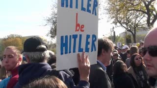 A sign at a political rally says Let Hitler Be Hitler.
