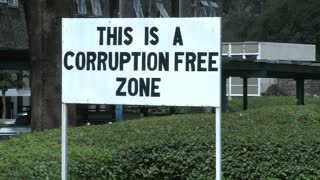 A sign at the University of Nairobi in Kenya proclaims a corruption free zone.