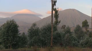 A strange cloud formation forms at the summit of the Virunga volcano chain on the Rwanda Congo border.