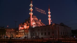 A tram passes in front of a mosque in istanbul, Turkey at night.