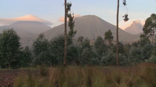 A wide shot of the Virunga volcano chain on the Rwanda Congo border.