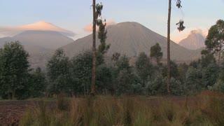 A wide shot of the Virunga volcano chain on the Rwanda Congo border.