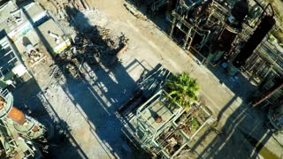 Aerial looking down a smokestack over an abandoned oil refinery.