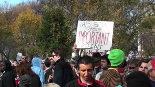 An ironic sign announces its own importance at the Jon Stewart Stephen Colbert rally in Washington DC.