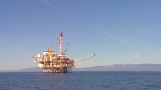 An oil platform off the coast of Santa Barbara, California, as seen from a boat passing nearby.