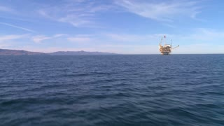An oil platform off the coast of Santa Barbara, California, as seen from an approaching boat.