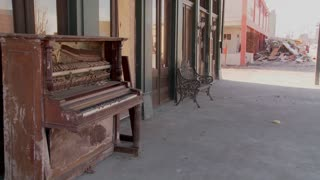 An old piano sits in front of a Glaveston bar after Hurricane Ike.
