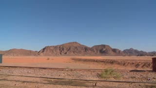 An old Turkish steam train used in the movie Lawrence of Arabia sits in the Saudi desert of Wadi Rum, Jordan.