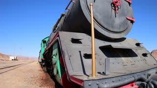 An old Turkish steam train used in the movie Lawrence of Arabia sits in the Saudi desert of Wadi Rum, Jordan.