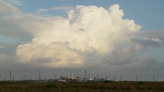 Beautiful time lapse of clouds over an oil refinery.