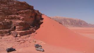 Bedouin trucks explore the vast desert sands of Wadi Rum, Jordan.