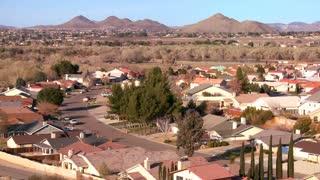 Birds eye view over neighborhoods and suburban sprawl in a desert community.