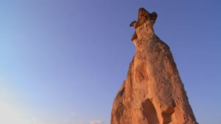 Bizarre geological formations looks like a cowboy wearing a hat at Cappadocia, Turkey.