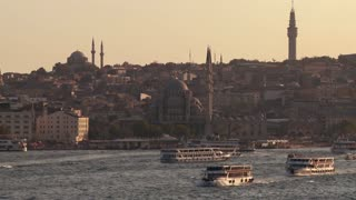 Boats and ferries cross the busy Bosphorus in istanbul, Turkey.