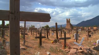 Christian graves and crosses in the Taos pueblo cemetery.
