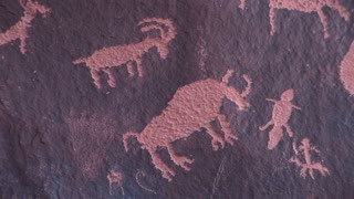 Close-up of Native-American petroglyphs picturing animal figures at Newspaper Rock, Utah.