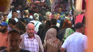 Crowds of people walk in the Arab Quarter of the old city of Jerusalem.
