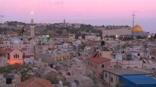Day changes to night in this time lapse shot over the Old City of Jerusalem.