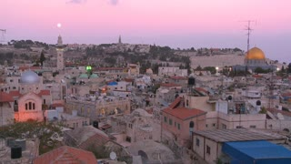 Dusk over the old city of Jerusalem with the moon rising.