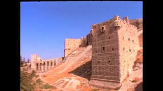 Establishing shots of the city of Allepo, Syria in 1996 including the Citadel.