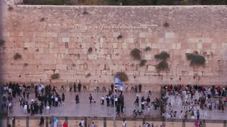 ewish pilgrims praying at the Wailing Wall in Jerusalem, Israel.