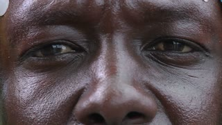 Extreme close up of the eyes and nose of an African man.