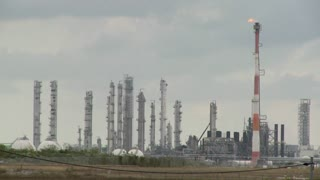 Fire burns at an oil refinery.