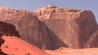 Hikers explore the vast desert sands of Wadi Rum, Jordan.