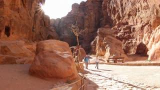 Horsecarts pass through the narrow canyons leading up to Petra in Jordan.
