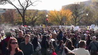 Huge crowds mill about at a political protest in Washington D.C.