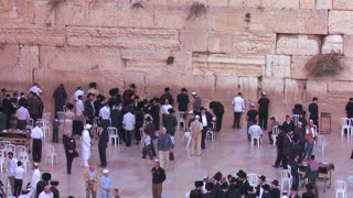 Jewish pilgrims praying at the Wailing Wall in Jerusalem, Israel.