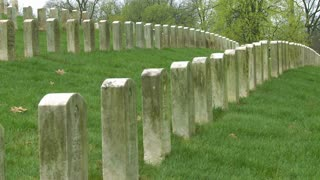 Long rows of graves mark a World War One cemetery.