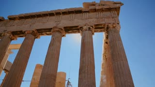 Low angle of the columns of the Acropolis and Parthenon on the hilltop in Athens, Greece.