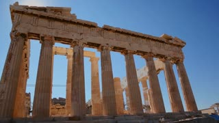 Low angle shot of the columns of the Acropolis and Parthenon on the hilltop in Athens, Greece.