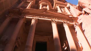 Low angle view of the facade of the Treasury building in the ancient Nabatean ruins of Petra, Jordan.