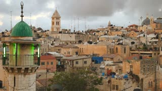Mosques, churches and synagogues line the skyline across a neighborhood in the Old City of Jerusalem, israel.