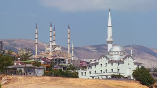 Mosques stand out on the horizon in a remote town in Azerbaijan, Georgia, Central Asia or Turkey.